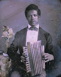 "One of the earliest uses in America was by French speaking Creoles in or near New Orleans, Louisiana, shortly after the instrument was invented. Often classically trained musicians who provided entertainment at white ""house concerts"", dances and elegant parties in Louisiana."